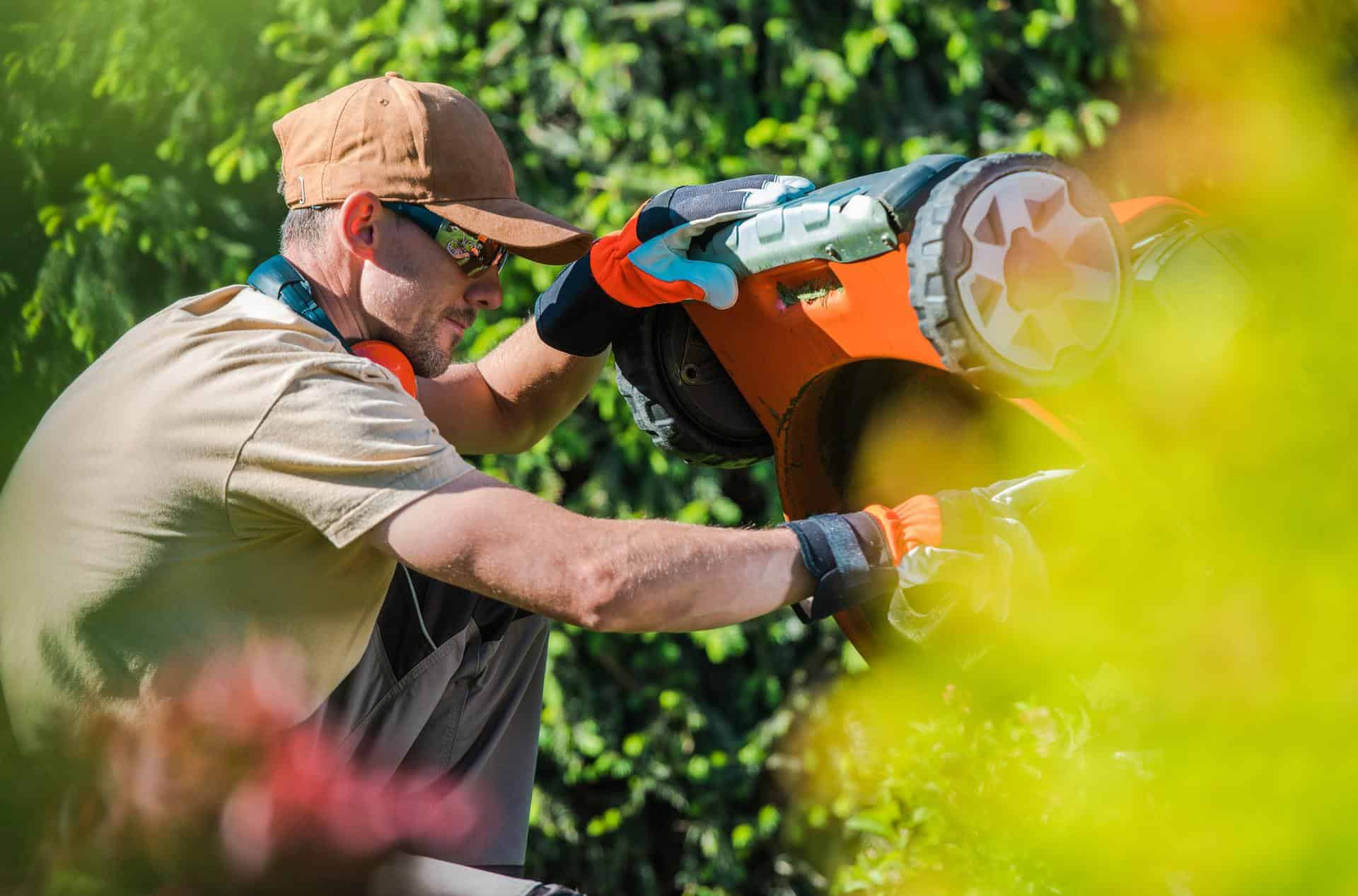 Men Fixing Lawn Mower